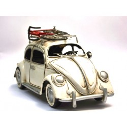 Coccinelle VW coloris blanc cassé, en fer peint